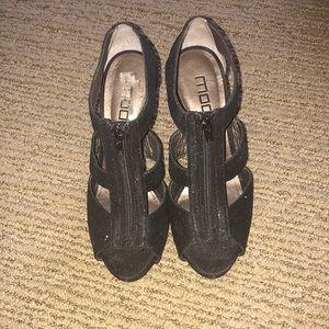 Zip up black heels